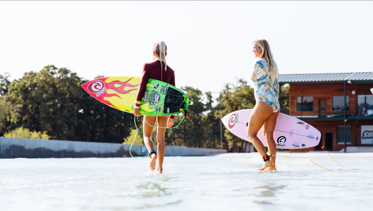 erin brooks and bethany hamilton walking with surfboards at bsr