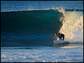 Heather Tiddens surf photo by Steve Bissell